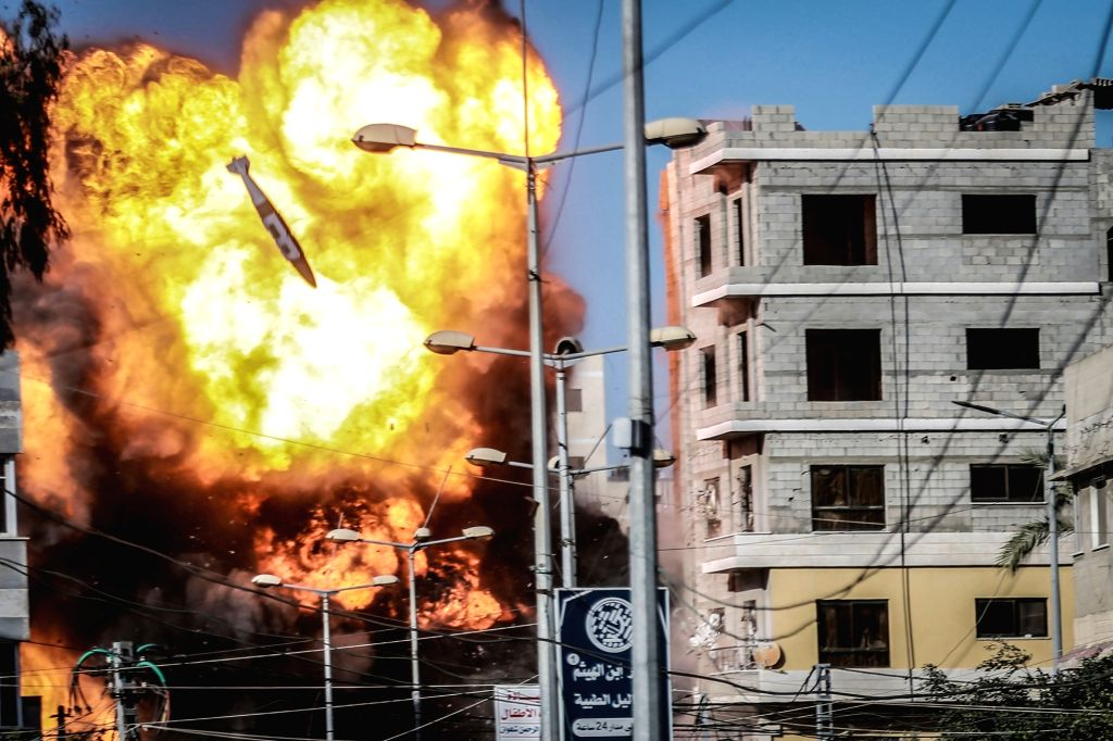 14 May 2021, Palestinian Territories, Gaza City: An Israeli rocket falls over buildings linked to the Palestinian Islamist movement Hamas in Gaza City, amid the escalating flare-up of ...