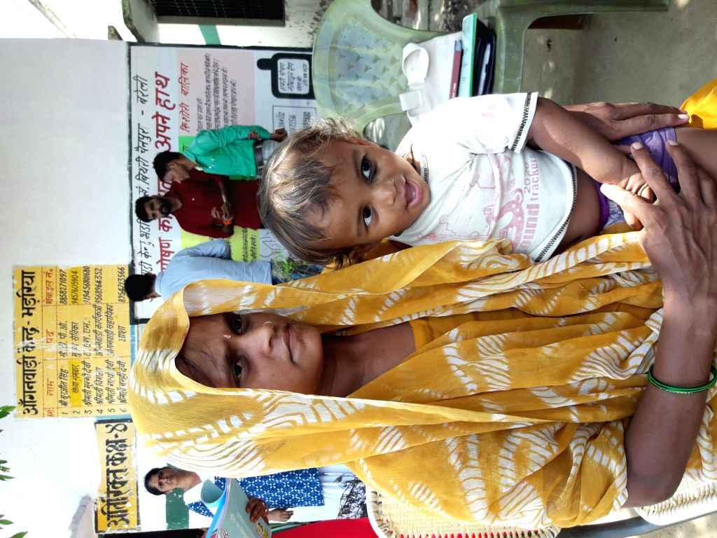 14-month-old Ayush with his mother Sudha at Anganwadi Centre in Bhandaria village of Uttar Pradesh's Bareilly district.