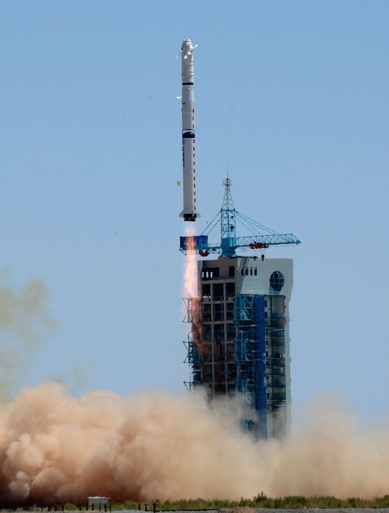 A Long March-4C carrier rocket carrying the Yaogan XX remote-sensing satellite blasts off from the launch pad at Jiuquan Satellite Launch Center in ...
