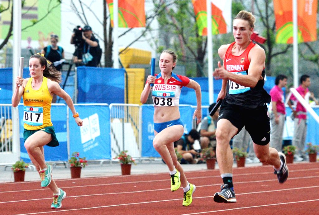 Merten Howe of Germany, a runner of Team 34 competes during the 8?100m Mixed Team Relay at Nanjing 2014 Youth Olympic Games in Nanjing, east China's ...