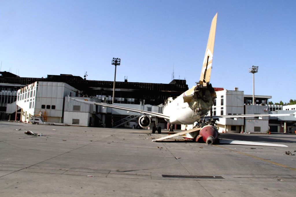 Photo taken on Aug. 26, 2014 shows a severely damaged plane in Tripoli International Airport, in Tripoli, Libya. Since July 13, the crucial air hub has .
