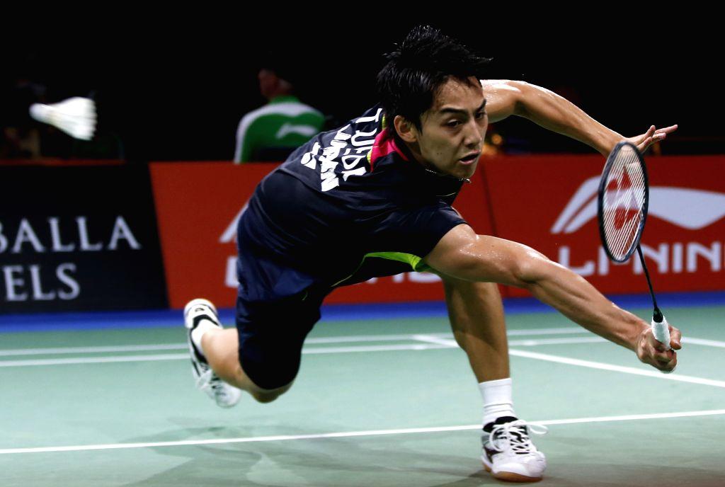 Takuma Ueda of Japan returns the shuttle during the Men's Singles Round 1 match against Tian Houwei of China on Day 2 of Li Ning BWF World ...