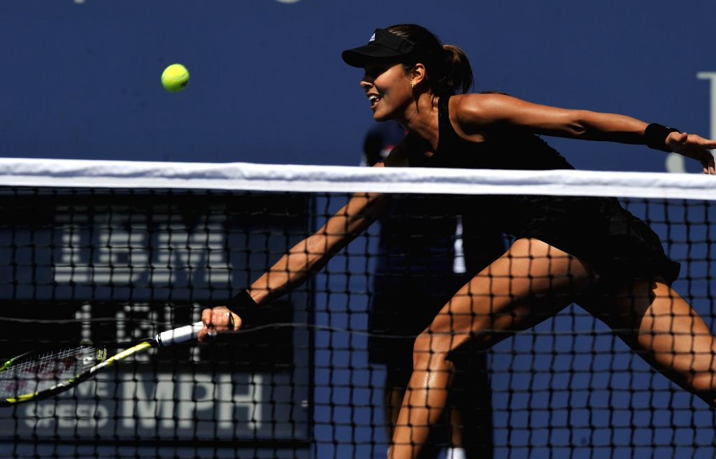 Ana Ivanovic of Serbia hits a return during the women's singles 1st round match against Alison Riske of the United States at the U.S. Open tennis ...