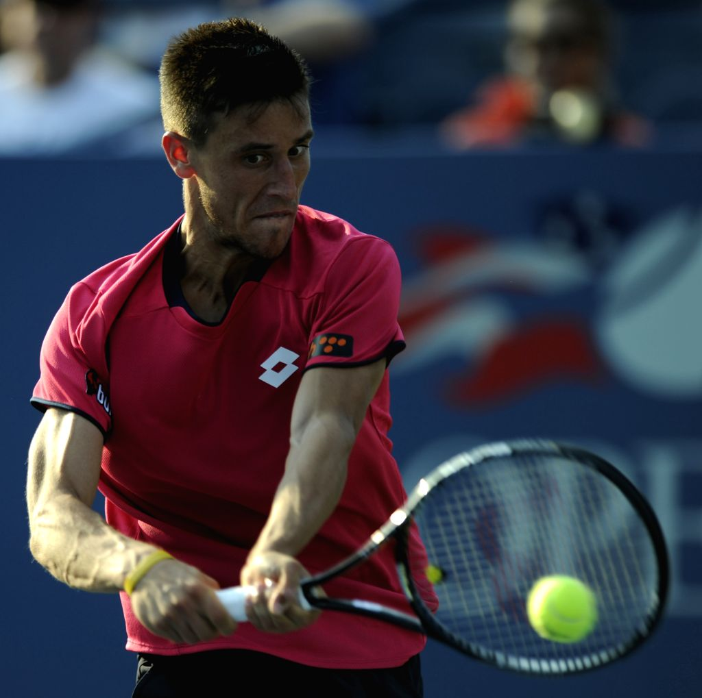 Damir Dzumhur of Bosnia and Herzegovina returns the ball during the men's singles 1st round match against David Ferrer of Spaina at the U.S. Open ...