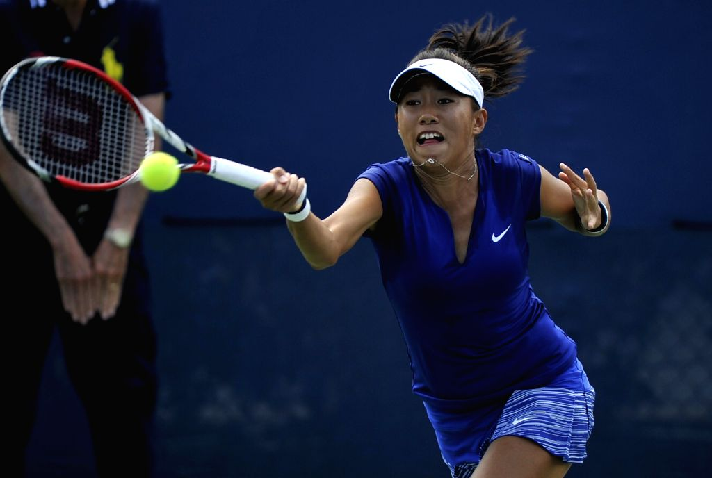 Zhang Shuai of China returns the ball during the women's singles 1st round match against Mona Barthel of Germany at the U.S. Open tennis tournament in .