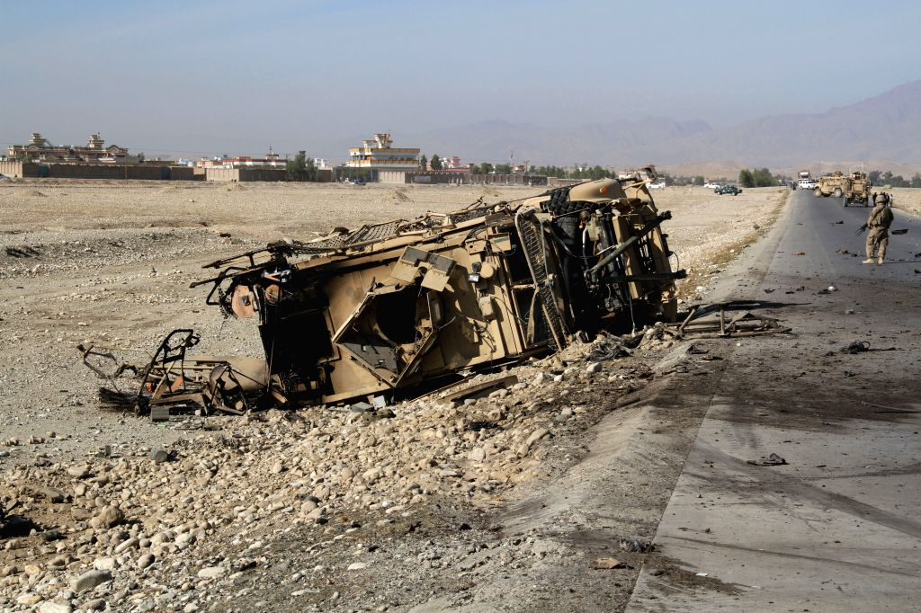 A destroyed U.S. military vehicle is seen at the site of suicide car bombing in Nangarhar province in eastern Afghanistan, Nov. 13, 2014. Earlier on ..