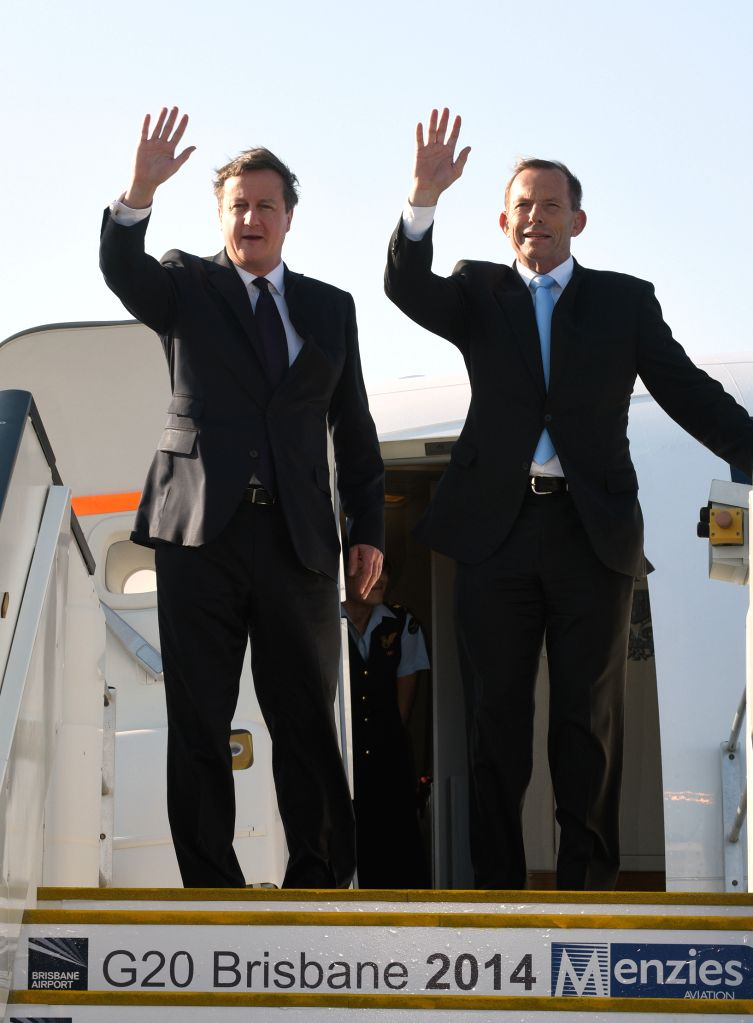 British Prime Minister David Cameron (L) and Australian Prime Minister Tony Abbott arrive at Brisbane Airport to attend the G20 Summit in Brisband, ... - David Cameron