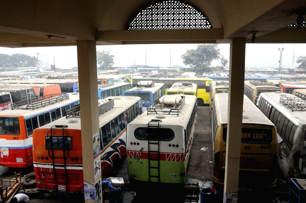 Long journey buses are parked in a bus stand during the nationwide strike in Dhaka, Bangladesh, Dec. 31, 2014. Bangladesh's largest Islamist party ...