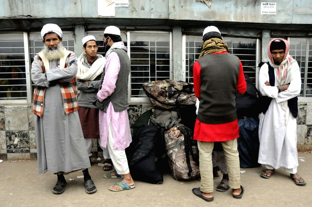 Passengers wait for transport at a bus stand during the nationwide strike in Dhaka, Bangladesh, Dec. 31, 2014. Bangladesh's largest Islamist party ...
