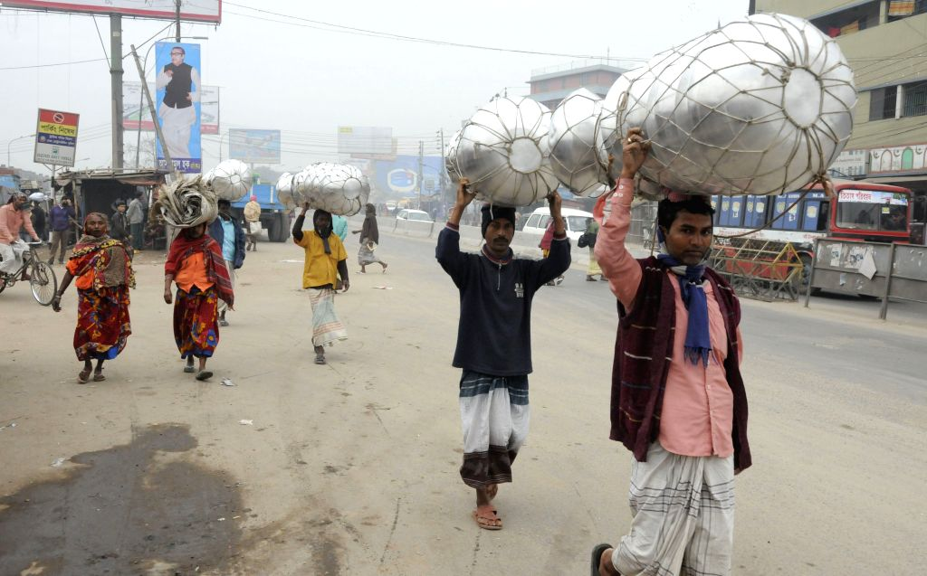 Peddlers carry pots for sale during the nationwide strike in Dhaka, Bangladesh, Dec. 31, 2014. Bangladesh's largest Islamist party Jamaat-e-Islami has ...
