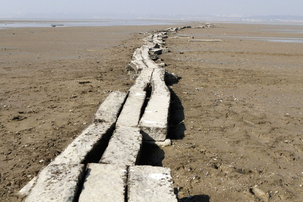 A stone bridge relic of Ming Dynasty (1368-1644) is revealed on the bed of drought-affected Poyang Lake in east China's Jiangxi Province, Dec. 30, ...