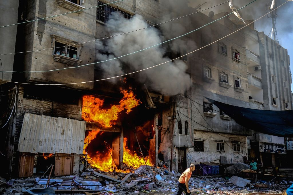 15 May 2021, Palestinian Territories, Rafah: A fire breaks out at a house hit by an Israeli airstrike on Rafah, amid the escalating flare-up of Israeli-Palestinian violence. Photo: Abed Rahim ...