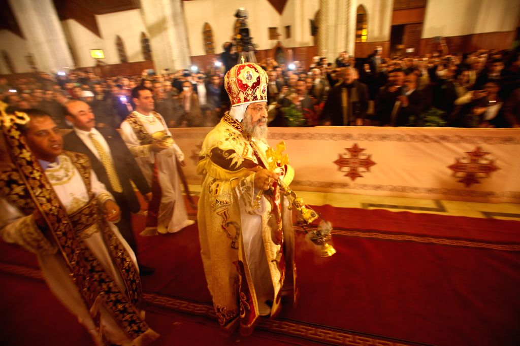 Coptic Pope Tawadros II leads the Coptic Christmas Eve mass at the Saint Mark's Coptic Orthodox Cathedral in Cairo, capital of Egypt, on Jan 6, 2015. ...