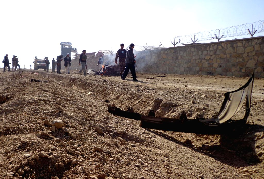 Afghan security forces inspect the site of an attack by Taliban militants in Khost province in eastern Afghanistan, Jan. 7, 2015. A group of suicide ...