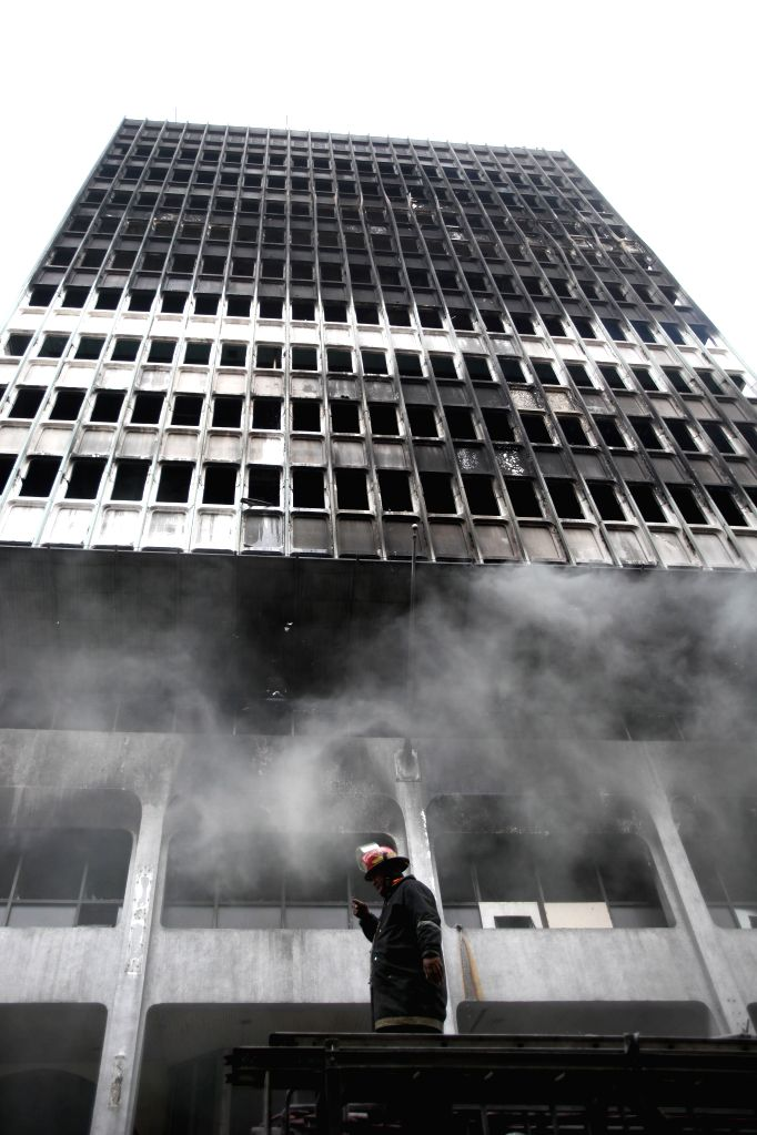 A firefighter works at the site of fire at a building in Manila, the Philippines, Jan. 7, 2015. An estimated 440,000 US dollars of damage was reported by .