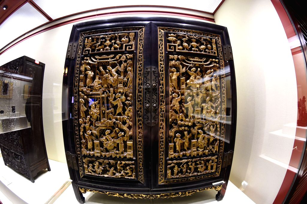 A closet with gilded hollow carvings is shown at a new exhibition hall of the Imperial Palace Museum in Shenyang, capital of northeast China's Liaoning