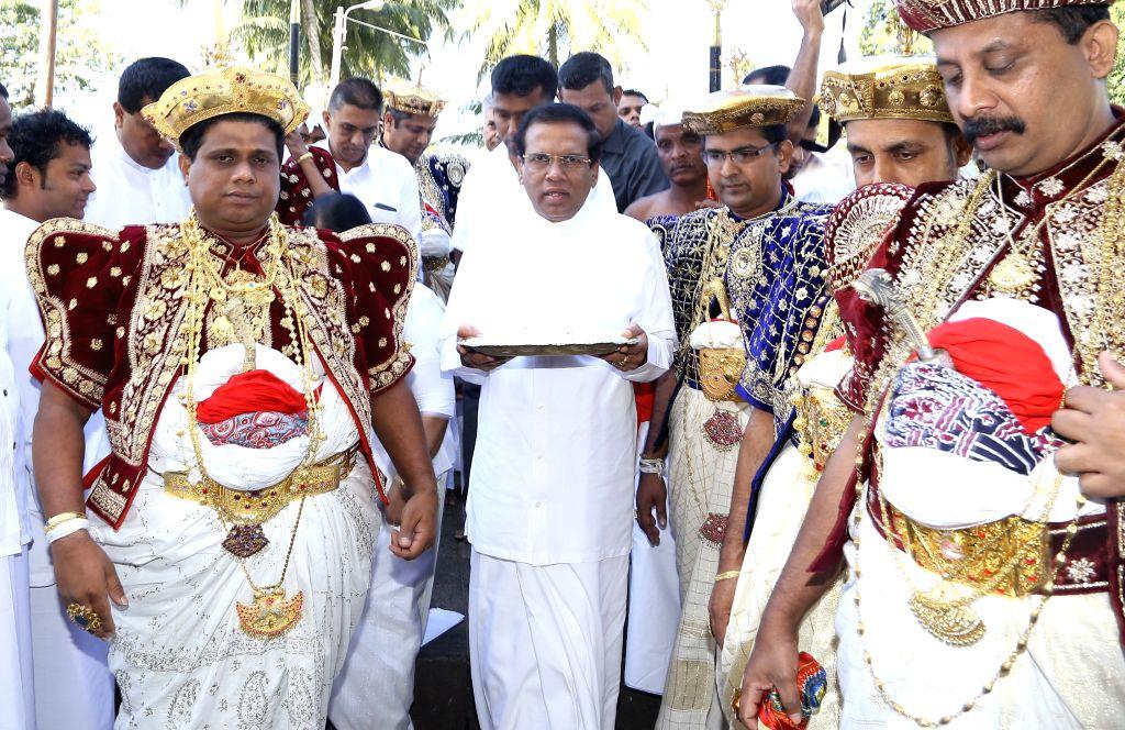 New President Maithripala Sirisena of Sri Lanka visits the Temple of Tooth in Kandy, Sri Lanka, on January 11, 2015.  In Sri Lanka where 70 percent of ...
