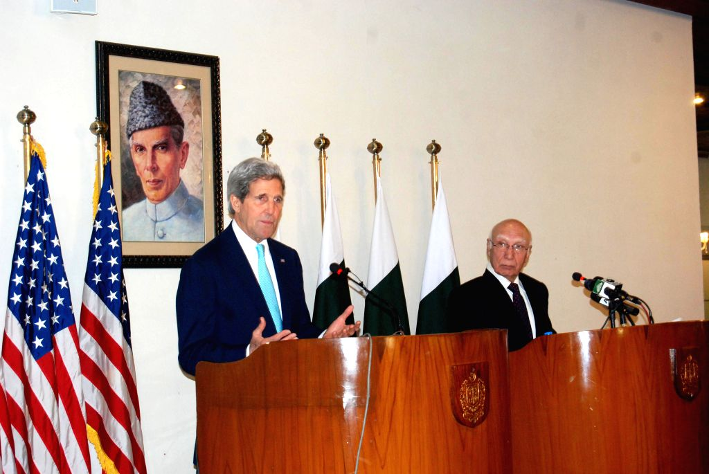 U.S. Secretary of State John Kerry (L) attends a joint press conference with Pakistani Adviser to the Prime Minister on National Security and Foreign .