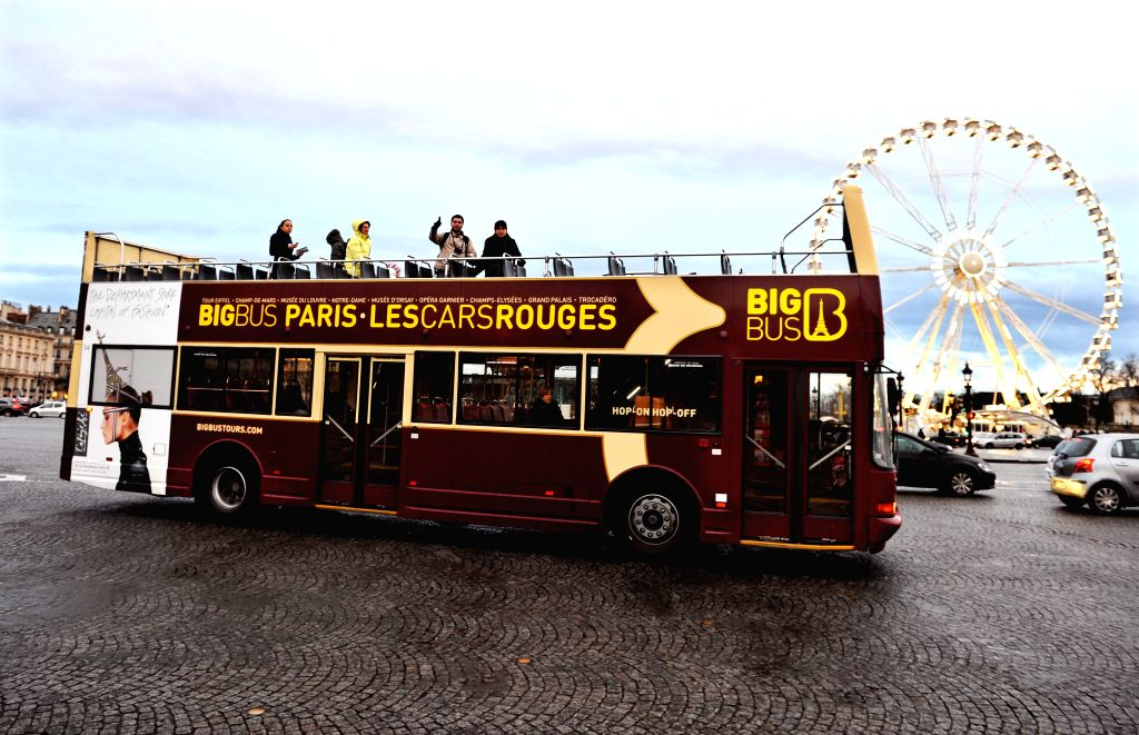 A tour bus with several tourists aboard runs on Place de la Concorde in Paris, France, Jan. 13, 2015. Facing high risks of terror attacks, French ...
