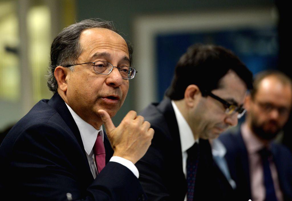 Kaushik Basu (front), World Bank chief economist and senior vice president, speaks to the press at the World Bank headquaters in Washington ... - Kaushik Basu