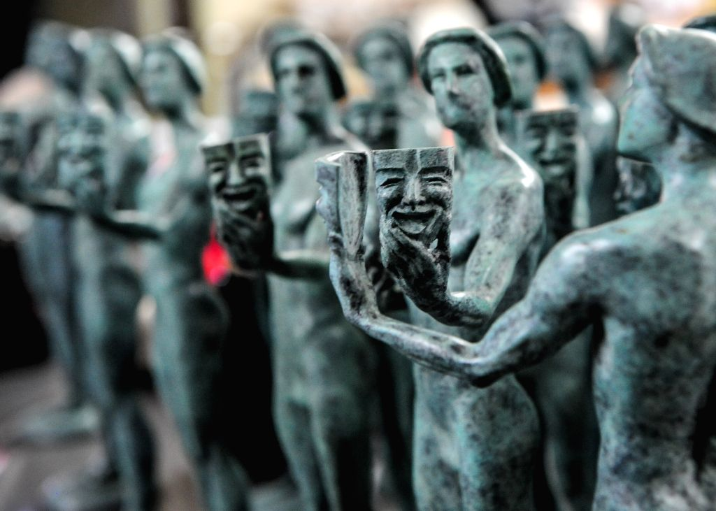 """The photo taken on Jan. 13, 2015 shows statuettes of """"The Actor"""" during a media event to display the production of the bronze statuette awards - Guild"""