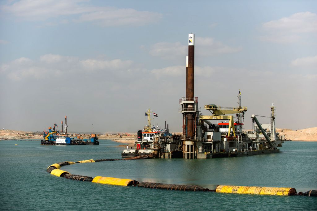 Digging machines work on the construction site of the New Suez Canal, in Ismailia, a city by the Suez Canal in Egypt, on Jan. 14, 2015.  Egypt launched the new .
