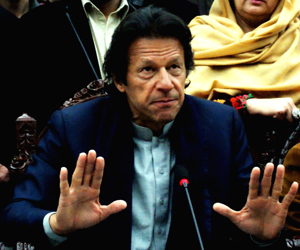 (150114) -- PESHAWAR, Jan. 14, 2015 (Xinhua) -- Pakistan Tehreek-e-Insaf chief Imran Khan addresses a press conference in northwest Pakistan's Peshawar on Jan. 14, 2015. Pakistan Tehreek-e-Insaf (PTI) Chairman Imran Khan and his wife Reham Khan encou - Imran Khan and Reham Khan