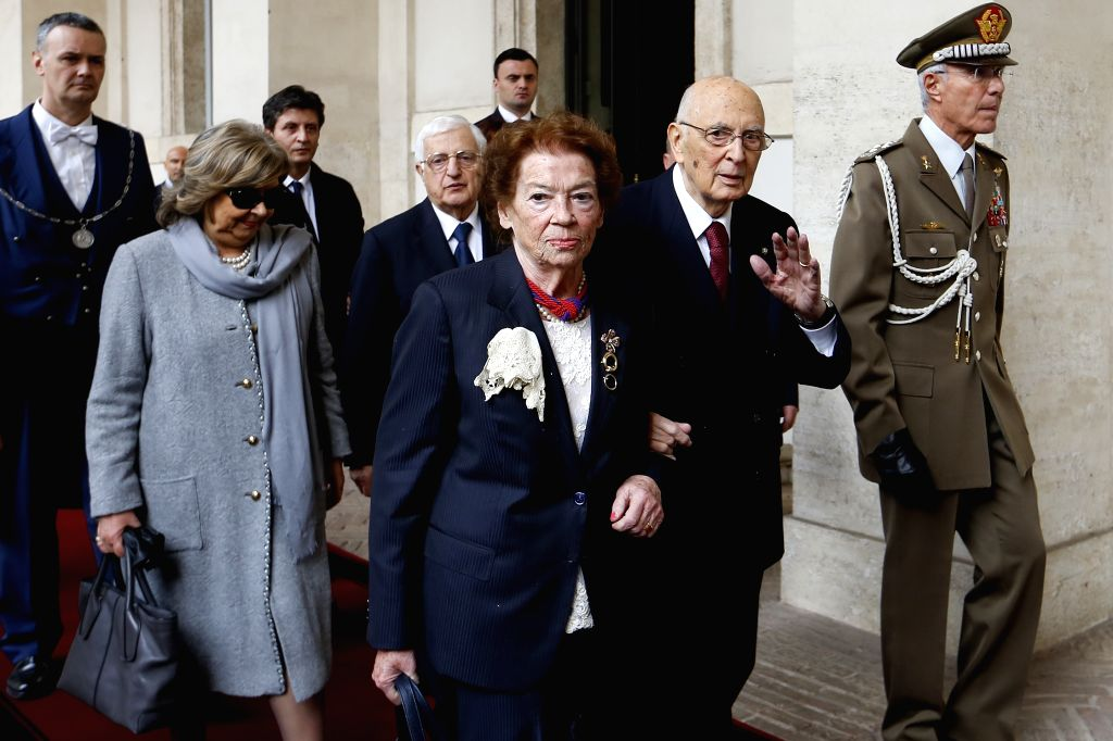 Italian President Giorgio Napolitano (2nd R) leaves the Quirinale palace in Rome, Italy, on Jan. 14, 2015. Italian President Giorgio Napolitano resigned on