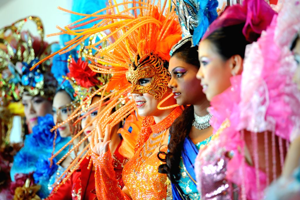 Singapore's Chingay performers attend a press conference held at Singapore's F1 Pit Building in Marina Bay, Jan. 14, 2015. Organisers of the Chingay ..