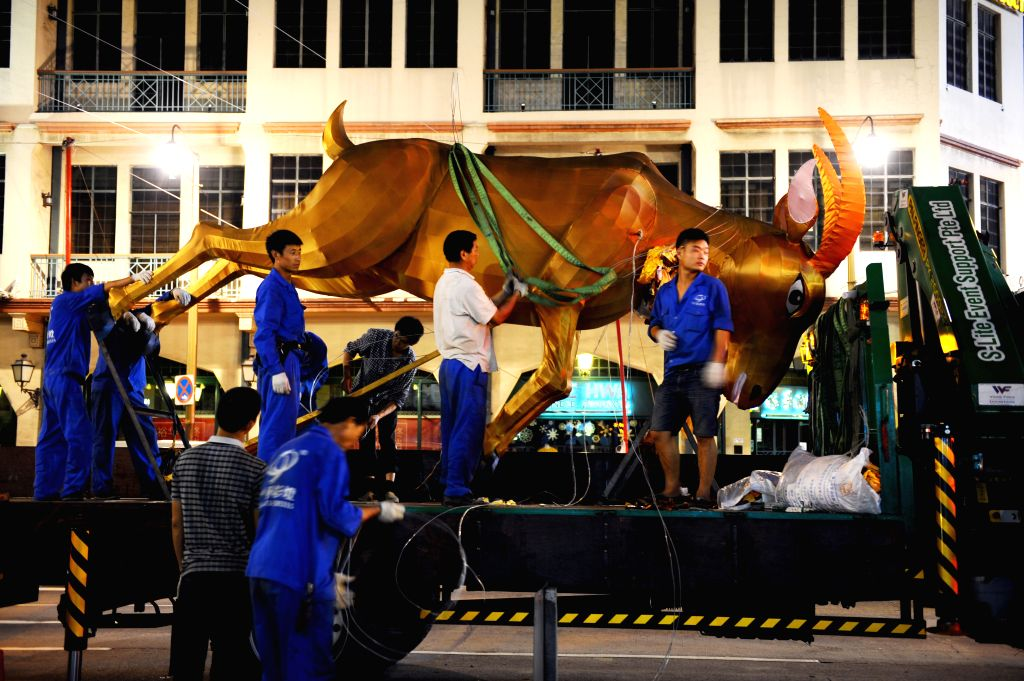 Workers prepare decorations in Chinatown area for the coming Lunar New Year of Goat in Singapore, Jan. 12, 2015.