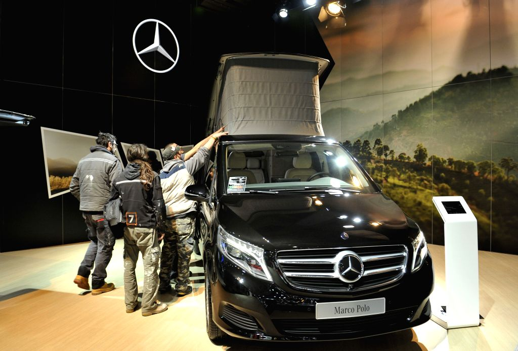 People check the roof of a Mercedes-Benz Marco Polo camper on the press day at the Brussels Motor Show in Brussels, Belgium, Jan. 15, 2015. The Motor ..