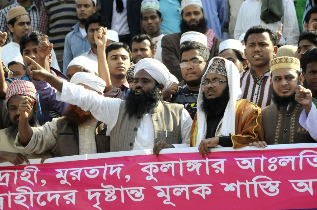 Bangladeshi Muslims attend a protest in Dhaka, Bangladesh, Jan. 15, 2015. Hundreds of Bangladeshi Muslims staged a protest on Thursday, demanding death ... - Abdul Latif Siddique