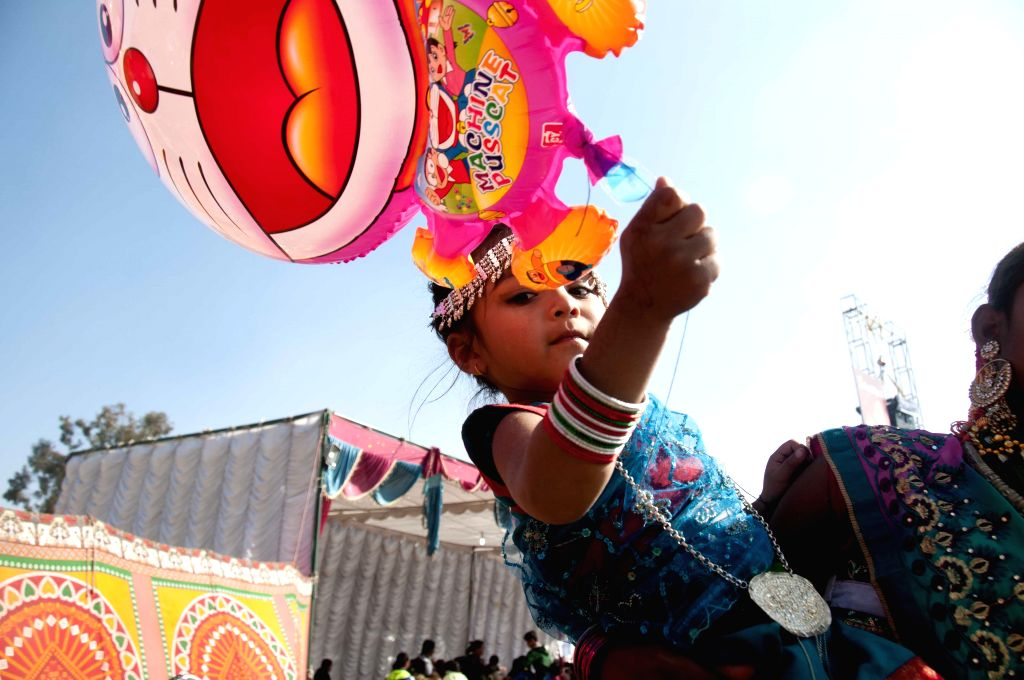 A Nepalese girl from Tharu community performs in her traditional attire during the Maghe Sankranti Festival in Kathmandu, Nepal, Jan. 15, 2015. Maghe .