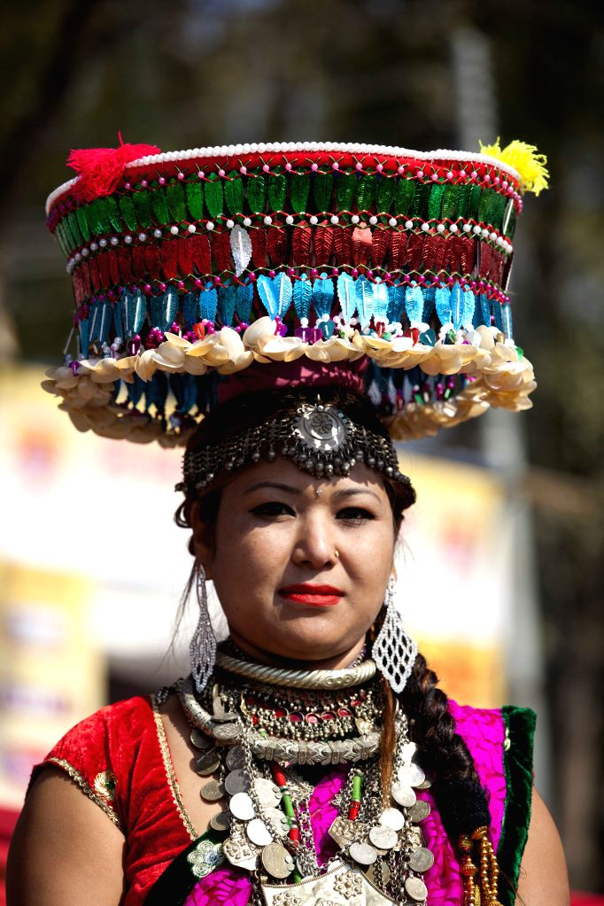 A Nepalese girl from Tharu community in her traditional attire celebrates the Maghe Sankranti Festival in Kathmandu, Nepal, Jan. 15, 2015. Maghe ...
