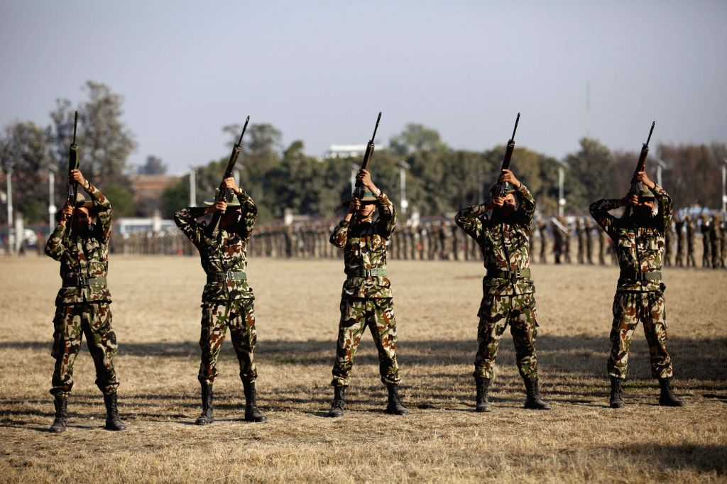 Nepalese soldiers take part in a drill of gun for the upcoming Army Day at the Parade Ground in Tundikhel of Kathmandu, Nepal, on Jan. 14, 2015. ...