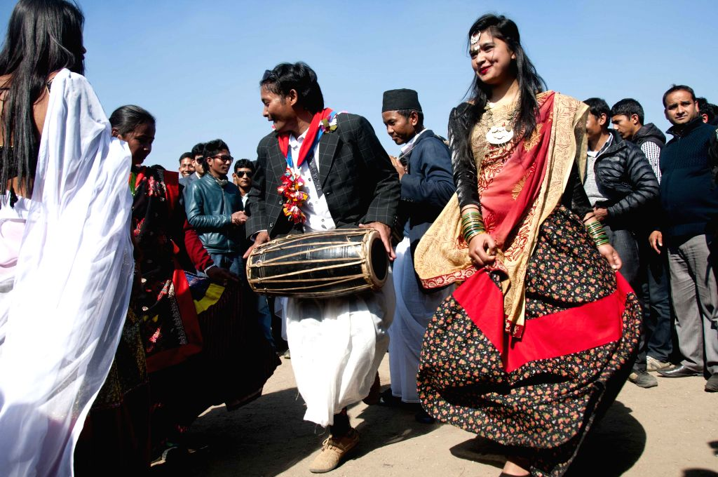 Nepalese girls from Tharu community perform in traditional attire during the Maghe Sankranti Festival in Kathmandu, Nepal, Jan. 15, 2015. Maghe ...