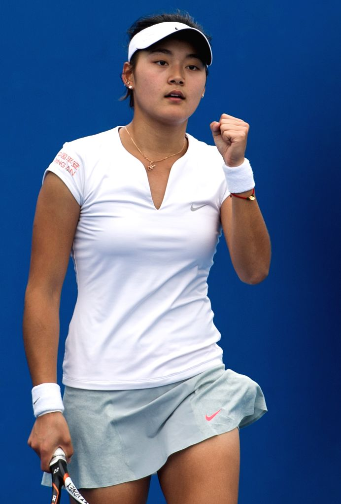 Wang Yafan of China celebrates during the women's singles qualifying first round match against Luksika Kumkhum of Thailand at the 2015 Australian Open