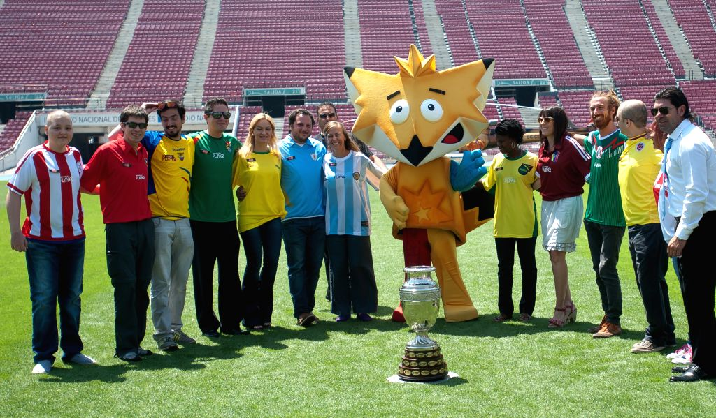 Representatives of countries competing in the 2015 Copa America Chile pose during the presentation of the trophy at the National Stadium in Santiago, ..