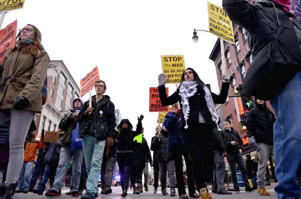 People attend a demonstration to shut down the traffic protesting against racism and injustice to mark the birthday of Martin Luther King Jr. in