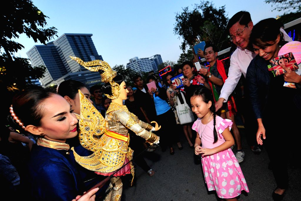 People look at a Thai puppet during Thailand Tourism Festival 2015 at Lumpini Park in Bangkok, Thailand, Jan. 15, 2015. Thailand Tourism Festival 2015 ..