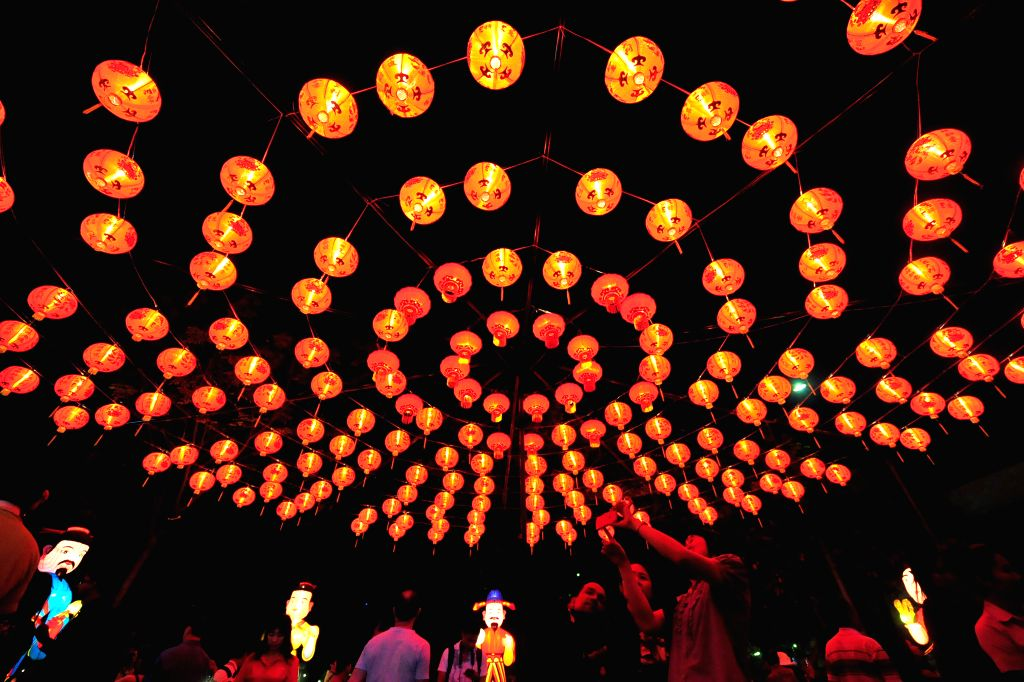 People take photos of lanterns during Thailand Tourism Festival 2015 at Lumpini Park in Bangkok, Thailand, Jan. 15, 2015. Thailand Tourism Festival 2015