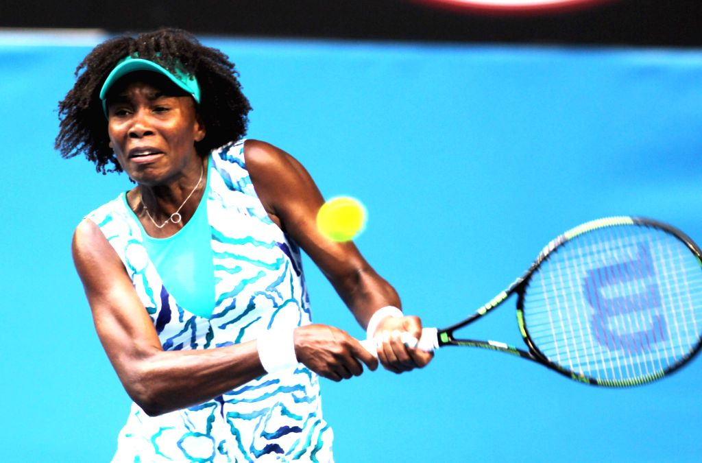Venus Williams of the United States returns the ball during her women's singles first round match against Spain's Maria-Teresa Torro-Flor at the ...