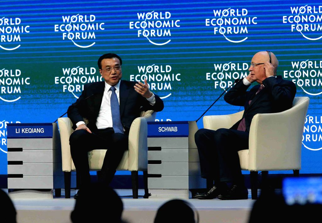 Chinese Premier Li Keqiang (L) answers questions at the World Economic Forum (WEF) annual meeting in Davos, Switzerland, on Jan. 21, 2015.  (Xinhua/Liu ...