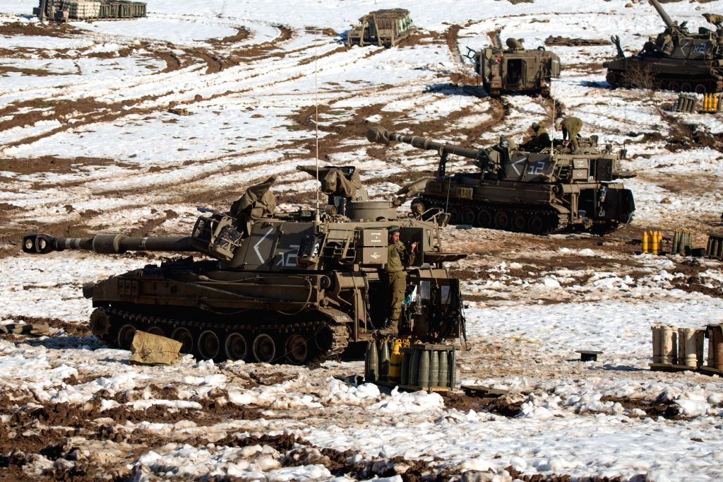 Israeli artillery units are deployed in the northern Golan Heights opposite the Syrian town of Quniatera, on Jan. 20, 2015. Israel stepped up ...