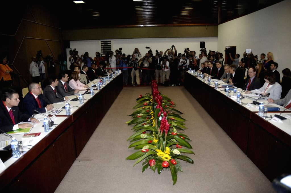 Delegates of the Unites States and Cuba meet at the Palace of Convention in Havana, Cuba, on Jan. 21, 2015. Cuba and the United States opened 2-day talks
