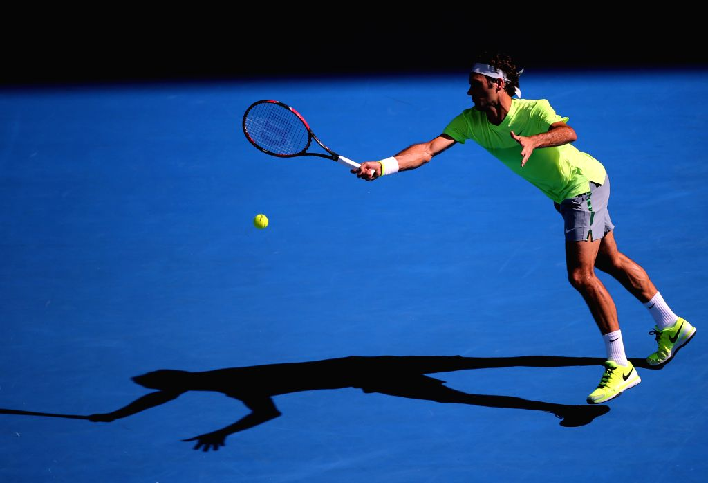 Roger Federer of Switzerland returns the ball during the second round match of men's singles against Simone Bolelli of Italy at the 2015 Australian ...