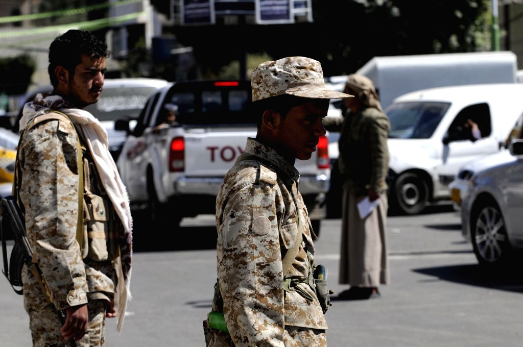 Houthi fighters check cars on a road leading to the house of President Abd-Rabbu Mansour Hadi in Sanaa, Yemen, on Jan. 21, 2015. Tensions mounted in ...