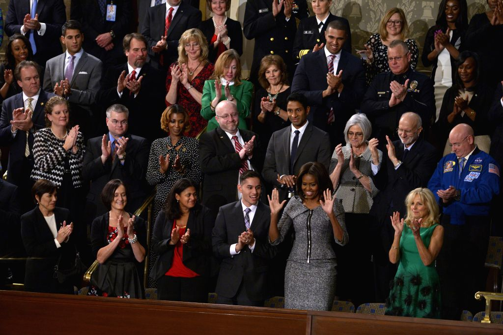 U.S. First Lady Michelle Obama (2nd R Front) arrives for the State of the Union Address to a joint session of Congress on Capitol Hill in ...