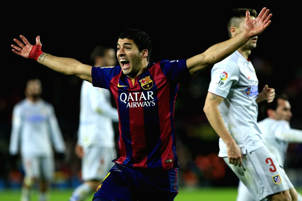 Barcelona's Uruguayan forward Luis Suarez reacts during the King's Cup quarter-final first leg soccer match against Atletico Madrid at the Nou Camp ..