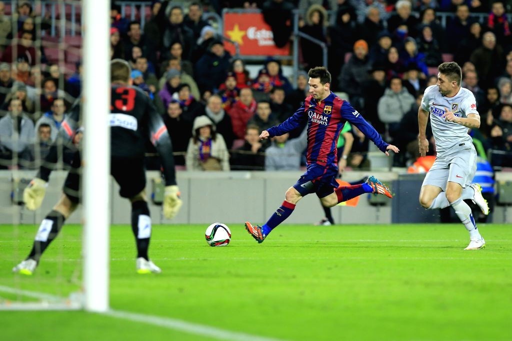 Barcelona's Argentine forward Lionel Messi in action during the King's Cup quarter-final first leg soccer match against Atletico Madrid at the Nou ...